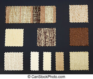 Multicolored furniture fabric samples over dark background