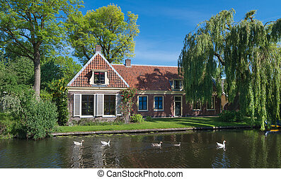 house at canal - traditional dutch house along a canal