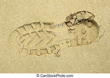 shoe print on the sand