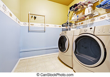 Laundry room interior in light blue and yellow colors -...