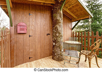 Tree house deck with entrance door