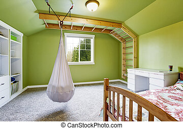 Kids room in bright green with hanging chair