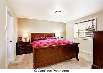 Bright bedroom interior with wooden bed