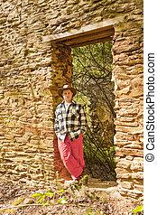 Casual Hispanic Man in Rock Wall