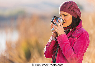 girl drinking coffee outdoors in autumn - girl drinking...