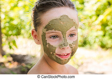 girl with facial clay mask