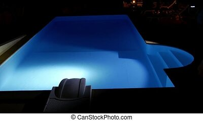 Man with Flashlight Inspects Pool at Night. Private House...