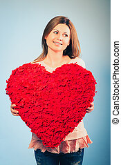woman hold Valentine day symbol
