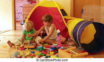 children playing with  toys in home interior