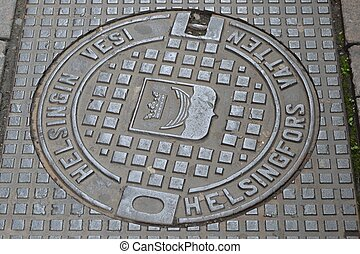 Sewer manhole in Helsinki - A cast-iron sewer manhole in the...