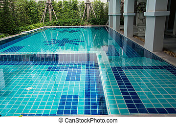 Residential swimming pool in backyard