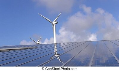 Solar panel array and wind turbines