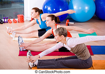 aerobics - Young women exercising in a step aerobics class