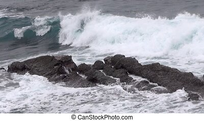 sea waves against rocks