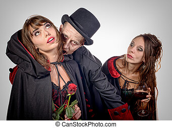two women and a man in disguise halloween - two women and a...