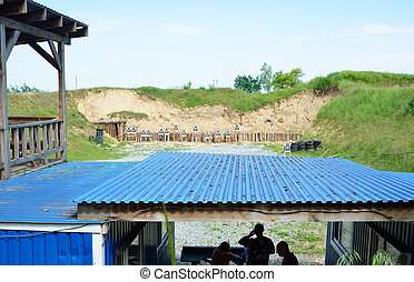 Shooting range outdoors - Some people are training in the...
