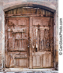 Vintage wooden double door in arch