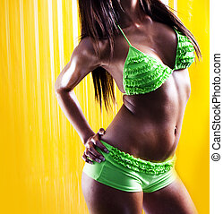 green bikini on yellow background