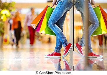 Girl with shopping bags - Shopping time, closeup of teenage...