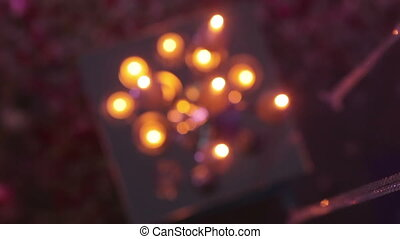 Burning candles in mirrors - Group of burning candles cage...