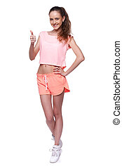 Young sporty woman - Pretty young sporty woman standing in...
