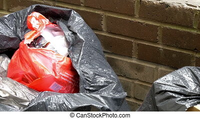 A black trash bag with garbage - A big black trash bag with...
