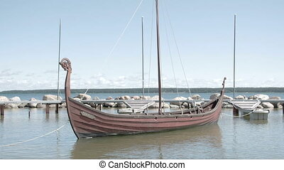 A viking boat floating on the sea of Estonia FS700 Odyssey...