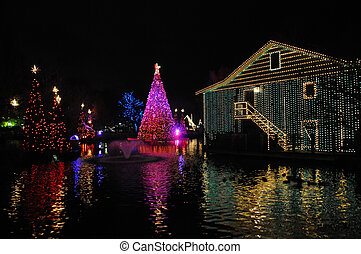 Christmas Night on the Water - A black nighst view of...