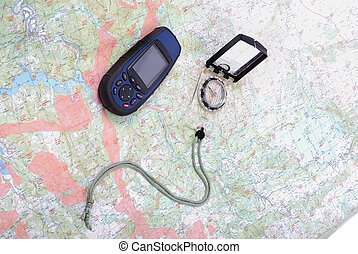 Map, gps and compass - Man, map, compass, gps turned off,...