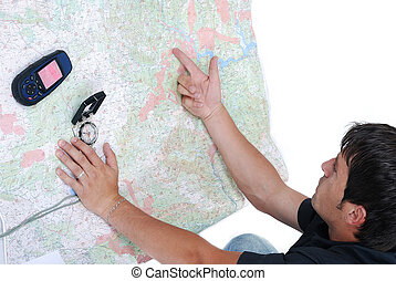 Man pointing on maps - Man, map, compass, gps, equipment all...