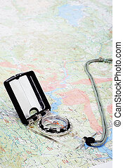 Compass laying on map - Maps, compass, gps and equipment...