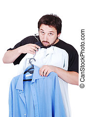 Young man with shirts - Young man is choosing shirt