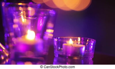 Burning candles on mirror - Group of burning candles cage on...