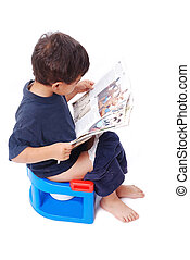Kid on little toilet