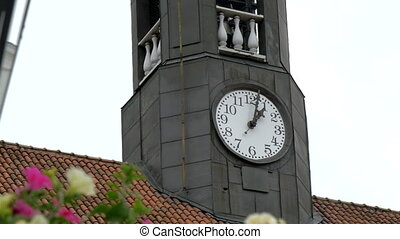 The tower clock from the old town hall in Tartu Estonia sets...