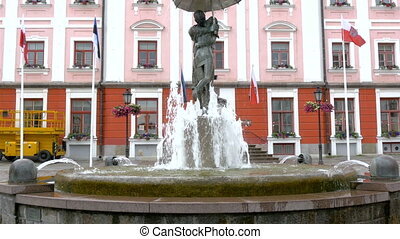 The kissing statue with water fountain infront of the town...