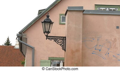 An old street lamp in Tartu Estonia - An old medieval street...