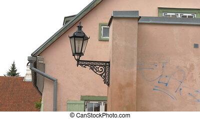 An old street lamp in Tartu Estonia - An old medieval street...