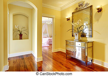 Bright hallway with shiny cabinet and flowers - Bright...