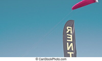 A surfing shape parachute flying in the sky FS700 Odyssey 7Q