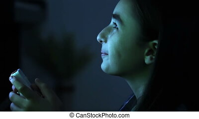 Girl is playing video games - Late in the evening a girl is...