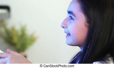 Girl playing video games - Girl is playing video games while...