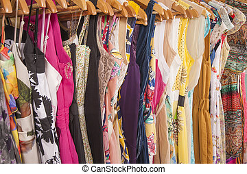 Womens clothes hanging on rail - Variety of colorful womens...