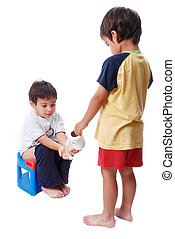 Kid is helping another one on toilet - Cute kid is sitting...