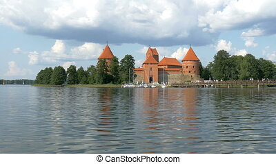 The nice view of the old castle in the middle of the river