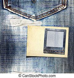 Vintage postcard with paper slides on old jeans background