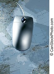 Computer silver wired mouse over blue map - Computer silver...