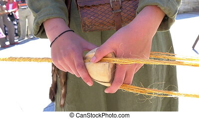 The making of the a rope where thin cords are rolled into one