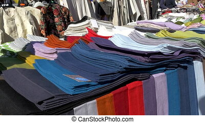 Colorful clothes being displayed on the street of Estonia