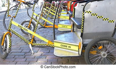 Lots of bike taxi or bicycle for rent. They have passenger...